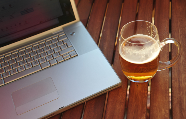 laptop and mug of beer